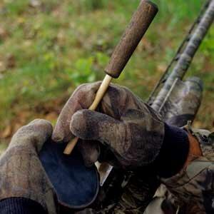 Close-up of a turkey hunter working a slate call