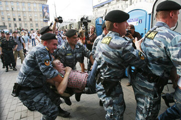 Protestors in the tourist friendly Red Square face off against police.