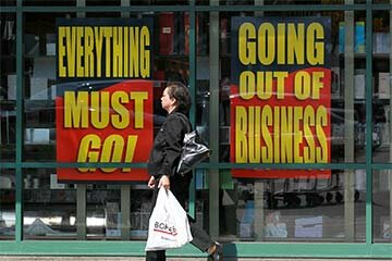 A Borders Books customer walks by signs advertising a going-out-of-business sale at a Borders bookstore on July 22, 2011 in San Francisco. Borders filed for Chapter 11 bankruptcy in February of that year.