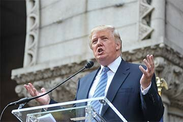 Donald Trump speaks during the Trump International Hotel Washington, D.C groundbreaking ceremony at Old Post Office. Despite declaring corporate bankruptcy four times, he's never declared personal bankruptcy, which allows him to keep his millions.