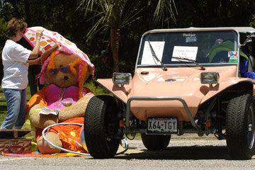 Image Gallery: Off-Roading Susan Archer makes adjustments at the display of a 1964 VW Dune Buggy during the Bay Area 15th Annual Monumental Bug Bash at San Jacinto Monument State Park in La Porte, Texas, on May 15, 2005. See more off-roading pictures.