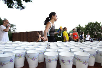 "Empty water cups are just some of the waste organizers of ""green"" triathlons are trying to reduce."