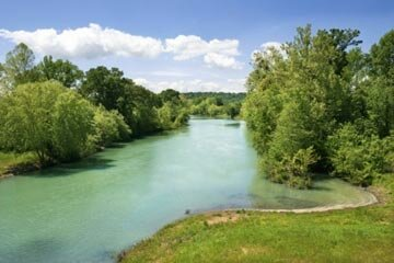 One of the many scenic river landscapes in the Ozarks. See pictures of national parks.