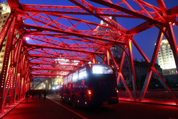 Night lights illuminate the truss on Shanghai's Waibaidu Bridge.