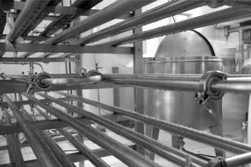 Inside an industrial pasteurization plant that processes of diverse variety of foods.