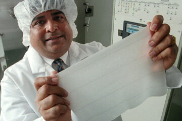 A man holds a piece of artificial skin from Integra. Grafts would be placed atop this piece.