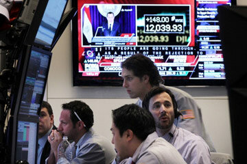 Investing Image Gallery Traders work the floor of the New York Stock Exchange on Feb. 1, 2011 as the Dow Jones Industrial Average soared to its highest level in two years, amid strong earnings reports from top companies. See more investing pictures.