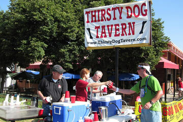 A thirsty runner pauses for refreshment.