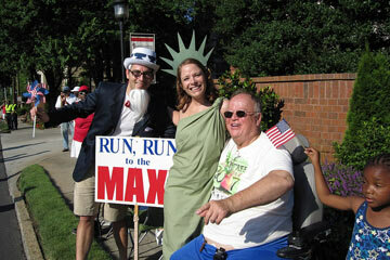 """Among the spectators: """"Uncle Sam,"""" """"Lady Liberty,"""" and former Georgia Sen. Max Cleland, wearing one of the coveted T-shirts, from a past race."""