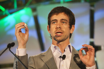 Jack Dorsey, creator of Twitter and founder of Square, holds up the Square device as he speaks during the TechCrunch Disrupt conference in New York in 2010.