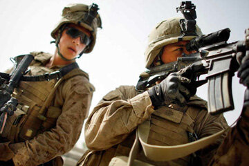 U.S. military personnel, like these Marines photographed in Afghanistan on July 9, 2009, are equipped with the world's most advanced weapons systems. See more gun pictures.