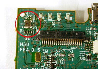 Piezoelectric sensors can be tiny -- the circled sensor provides motion-sensing capabilities for a PlayStation 3 controller.