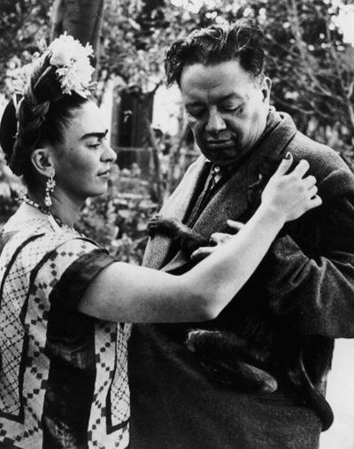 Diego Rivera and Frida Kahlo with their pet monkey