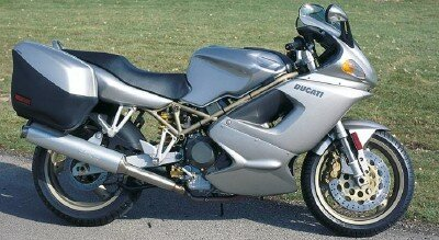 Ducati's desmodromic valvetrain helped the 1998 Ducati ST2 maintain a level of power and speed unusual in a touring bike. See more motorcycle pictures.