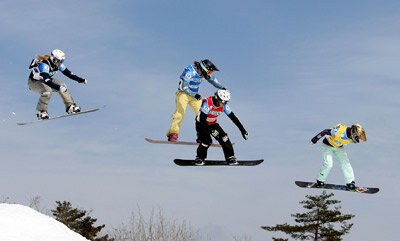 Lindsey Jacobellis, Sandra Frei, Olivia Nobs and Tanja Frieden fly through the air in the 2008 FIS World Cup.