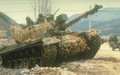 An M-48A5 Patton guards a convoy during Team Spirit Exercises in South Korea during 1984.