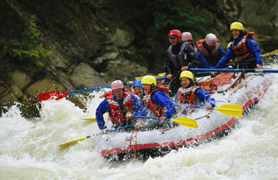 A team of rafters rides out the rapids of the Kicking Horse River in Yoho National Park, British Columbia.