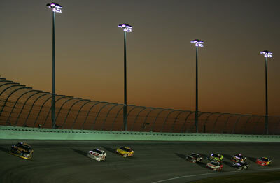 Cars race around the track in the NASCAR Nextel Cup Series Ford 400 at Homestead-Miami Speedway in Homestead, Fla., on Nov. 18, 2007.