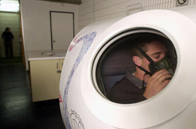 Athlete Brent Sherwin is treated inside a hyperbaric during training at Belmore Sports Ground, Sydney, Australia, in 2001. Portable hyperbaric chambers or gamow bags can be used to treat altitude sickness.