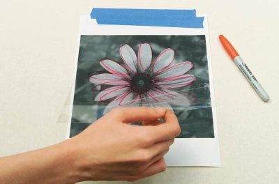 Make your own stencil by using a transparent material.
