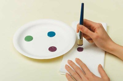 Paint colors should not touch on the palette; use a paper towel to offload excess paint.