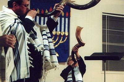 The shofar is blown in the synagogue during Rosh Hashanah services.