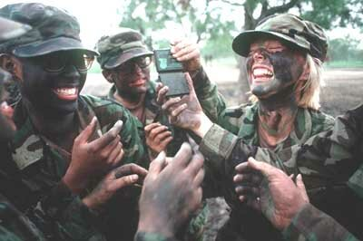 U.S. Air Force cadets put on camouflage clothing and face paint as part of boot-camp training. See more pictures of military camouflage.