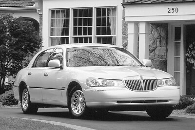The 1998 Lincoln Town Car redesign was conservative with softly rounded curves and a more upright front aspect.