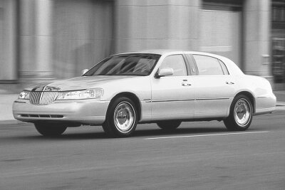 """The 2001 Lincoln Town Car Cartier imitated the """"stretch"""" that limos boasted, allowing for king-size rear leg room."""