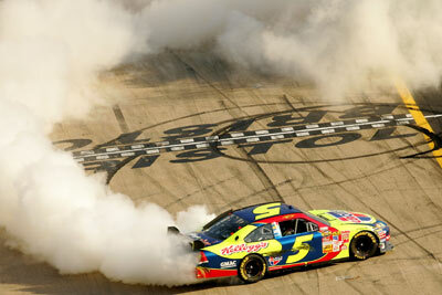 Kyle Busch, the first driver to win a race in the Car of Tomorrow, does a burnout after winning the NASCAR Nextel Cup Series Food City 500 at Bristol Motor Speedway on March 25, 2007, in Bristol, Tenn.