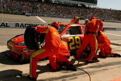Kevin Harvick's crew performs a pit stop during the NASCAR Nextel Cup Series Jim Stewart 400 at Richmond International Raceway on May 6, 2007, in Richmond, Va.