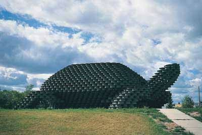 The W'eel Turtle Sculpture was made out of 2,000 tire rims by Dales Thrifty Barn, a gas station, cafe and motel in Dunseith, North Dakota.