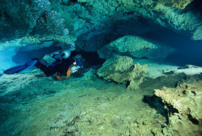 """Cave divers need to move through the water very carefully if they want to avoid """"the bends."""""""