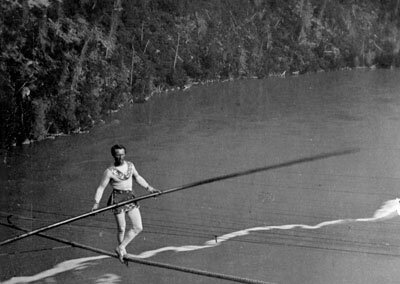 """French acrobat and tightrope-walker """"The Great Blondin"""" crossing Niagara on a tightrope."""