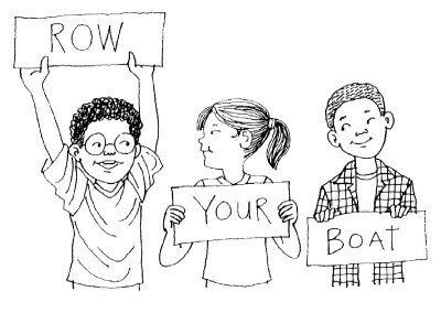 Kids use cue cards during a performance.