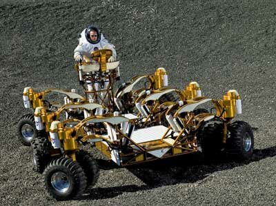 Space suit engineer Dustin Gohmert drives NASA's new lunar truck prototype through Johnson Space Center's Lunar Yard. The truck was built to make stuff like offroading easy.