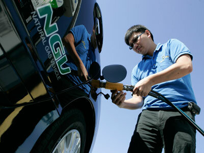Garvin Cui fuels up his natural gas vehicle at a Clean Energy station in San Francisco, Calif., on Sept. 4, 2008.