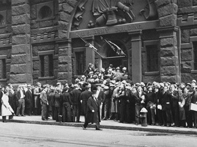 Young men showed up in droves to sign up for the CCC. Here, they're seen lining up outside an Army building in New York City for a chance to join.
