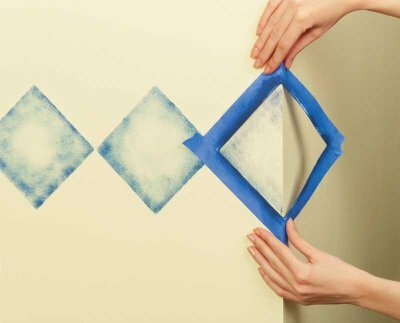 To stencil an outside corner, wrap the stencil around the corner, releasing the first side as you tape down the second.