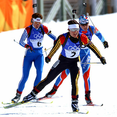 Female biathletes skiing freestyle in the 2002 Winter Olympics
