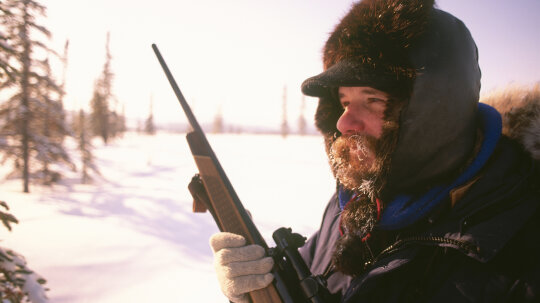 Would a knife or a gun serve me better in the Alaskan wilderness?