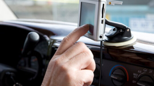 Is it more affordable to have a portable GPS system in your car or have the dealer install one?