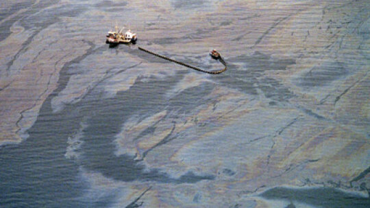 How do you clean up an oil spill?