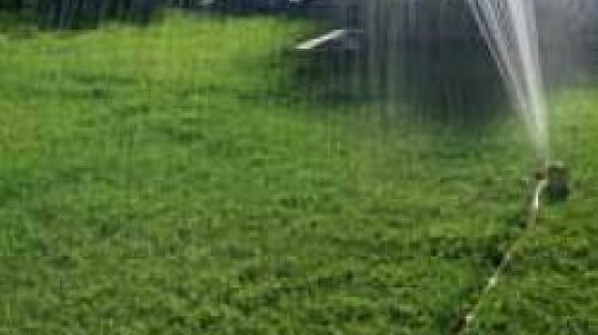 In built-in lawn sprinkling systems, there is a device called an anti-siphon valve. What is it for and how does it work?