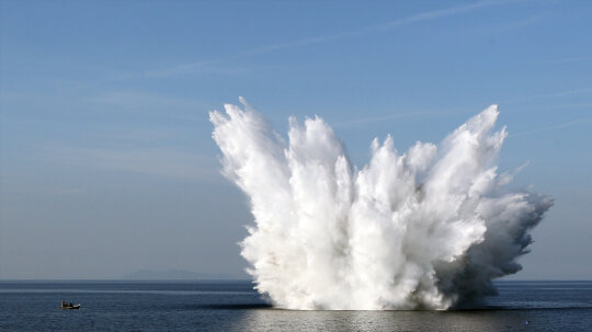 Is it worse to be near an explosion on land or in water?