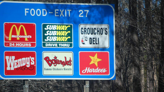 Who Does — and Doesn't — Get Featured on Blue Highway Exit Signs?