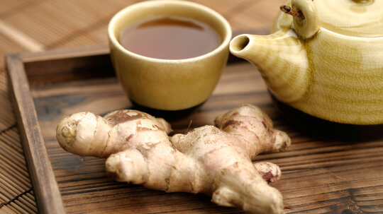 Why does ginger settle an upset stomach?