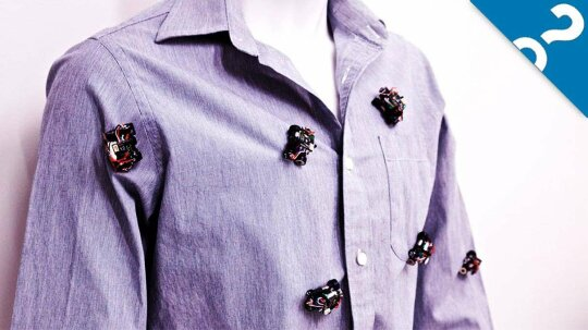 Rovables: Tiny Robots That Roll on Your Clothes All Day