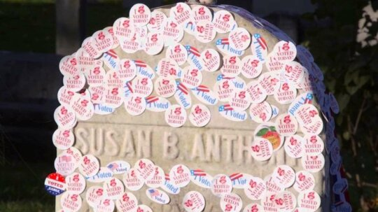 Thousands Line Up to Place Voting Stickers on Susan B. Anthony's Grave
