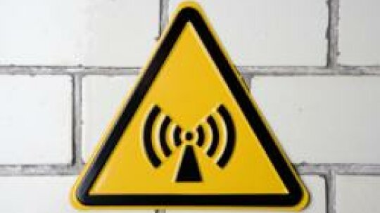 Do certain radio wave frequencies (like those used by cell phones) pose health risks?